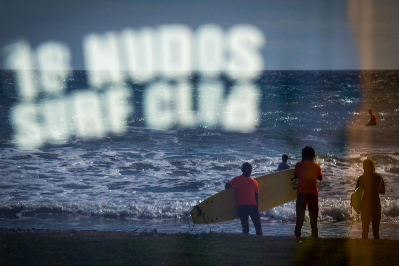 Surfers preparing